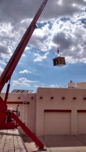 Air Conditioning Service, Repair and Installation Contractor Mission Heating & Cooling - Tucson AZ -  Crane lifts condensor unit to roof installing new  heating, ventilating, air conditioning system.